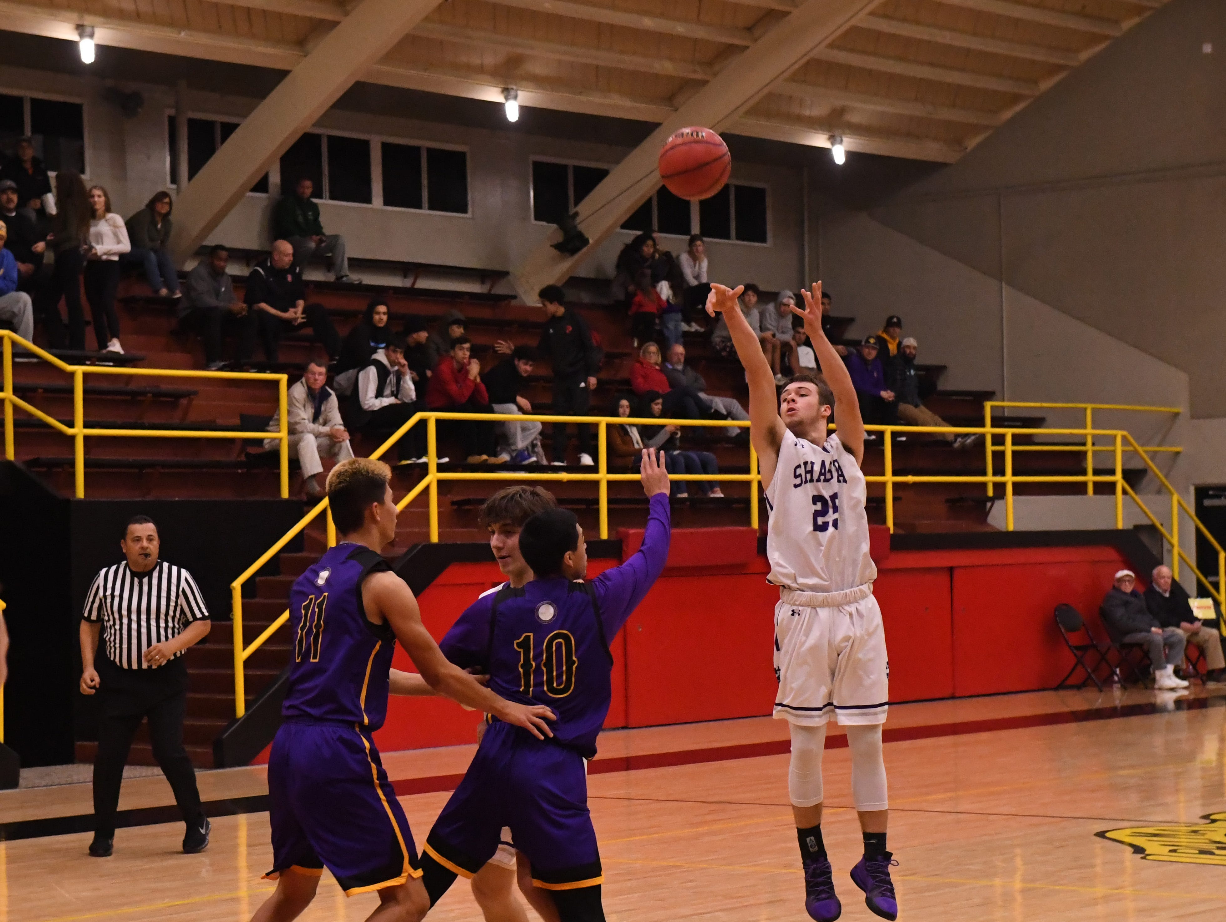 Shasta guard JT Beasley (25) releases a 3-point shot from the top of the arc.