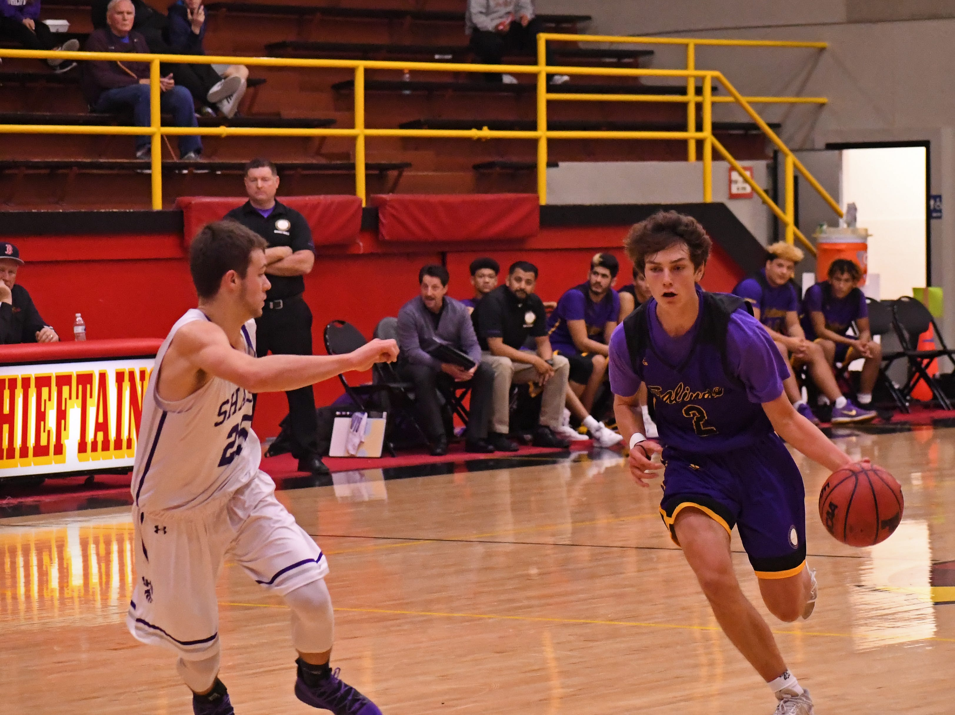 Salinas guard Parker Horton (2) drives to his left against a Shasta defender.