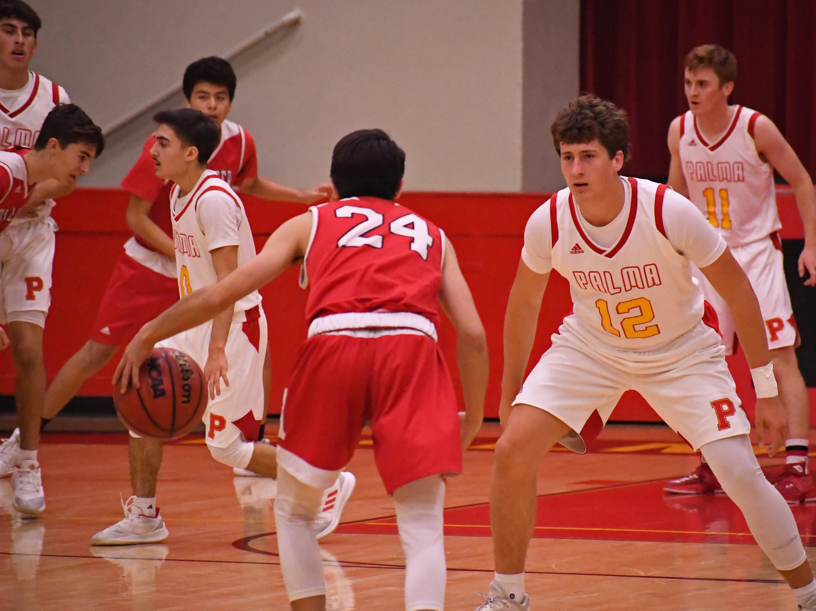 Palma forward Sam Lathos (12) keeps in front of his man on defense.