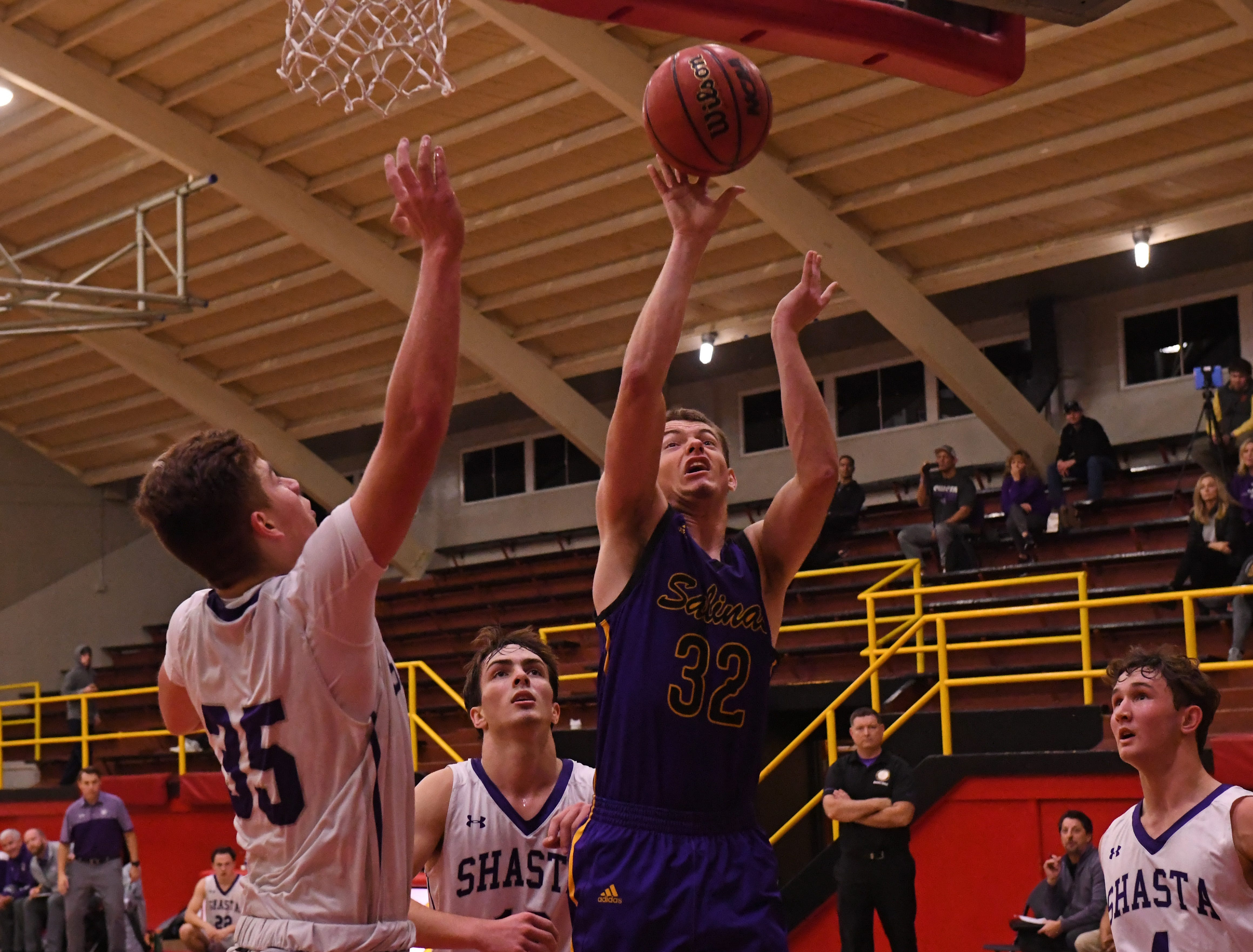 Salinas forward Carl Richardson (32) puts up a layup after getting an offensive rebound.