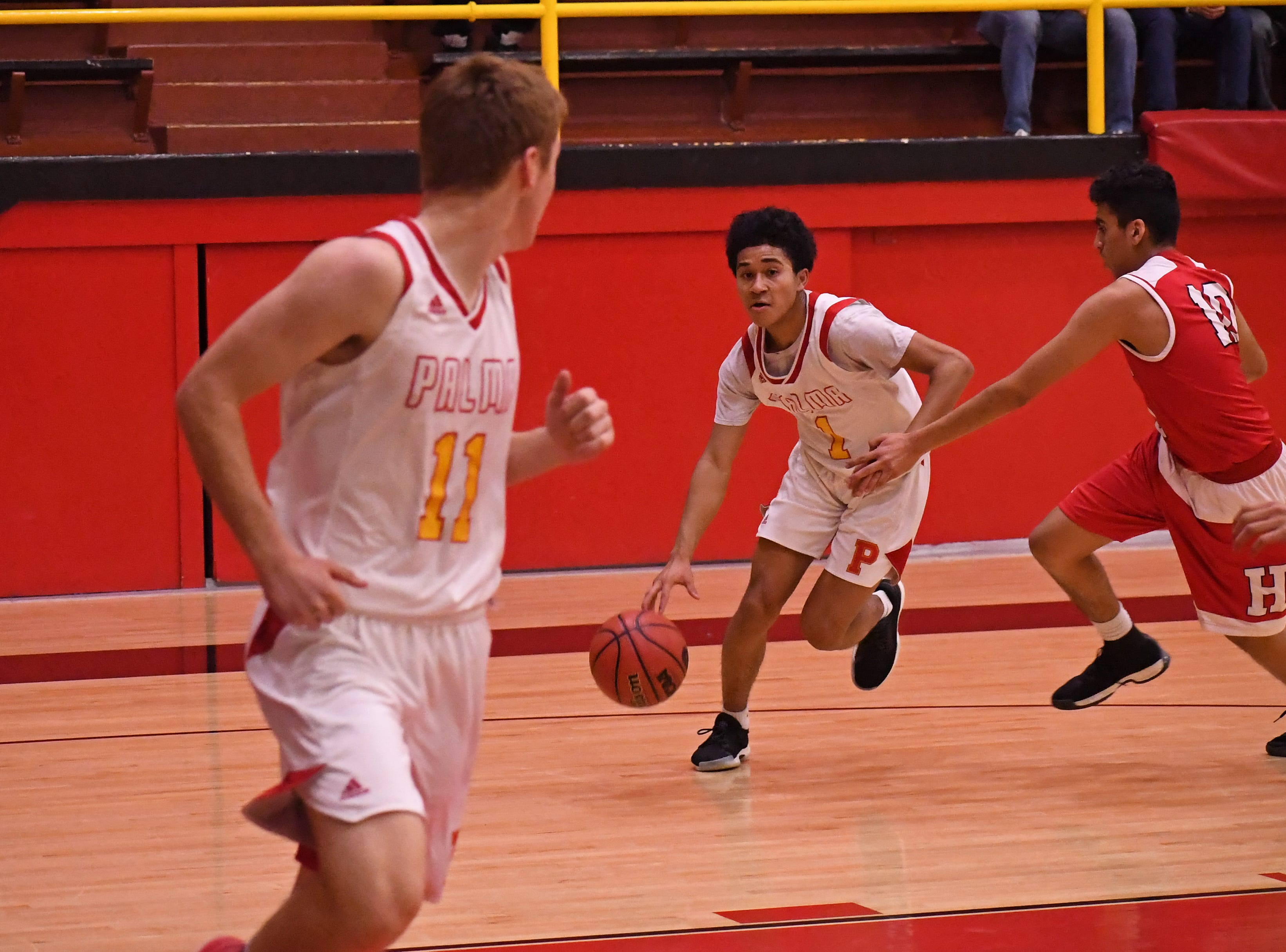 Palma guard Nate Jean-Pierre (1) drives past his defender and cuts to the basket.
