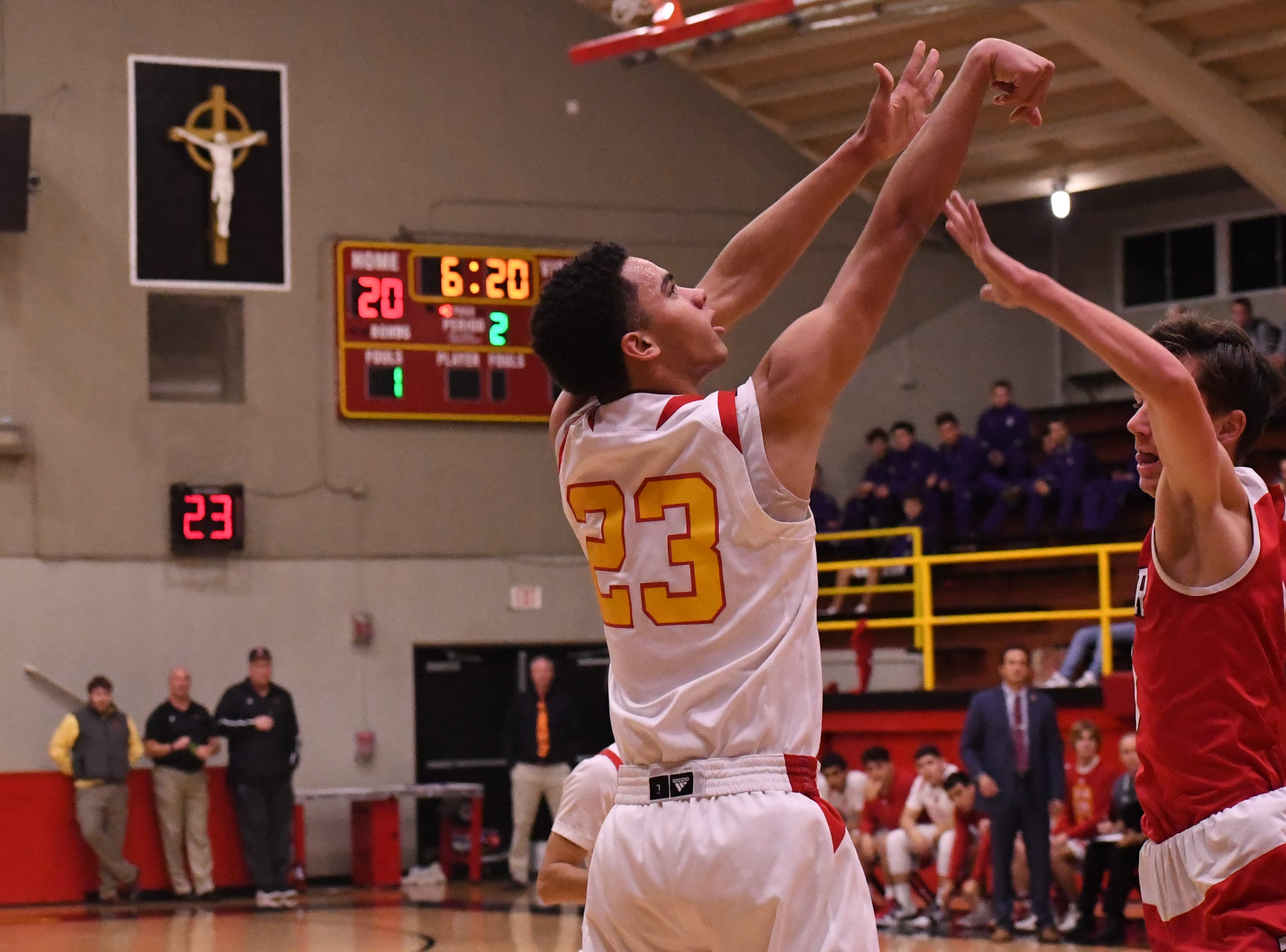 Palma forward Brenden Cannon (23) holds his release after shooting a jumper from the elbow.