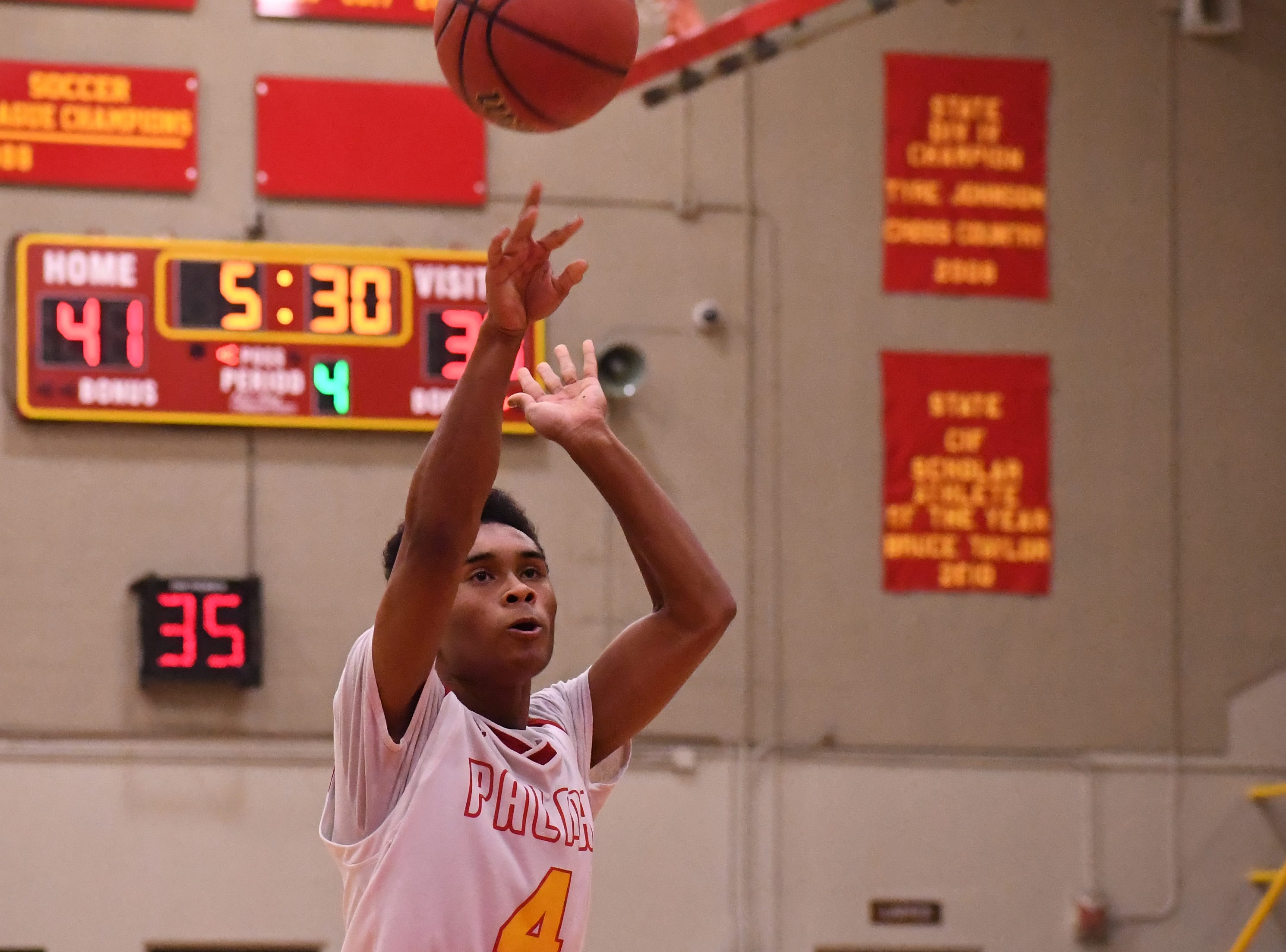 Palma guard Dante Jean-Pierre (4) shoots a free throw in the fourth quarter.