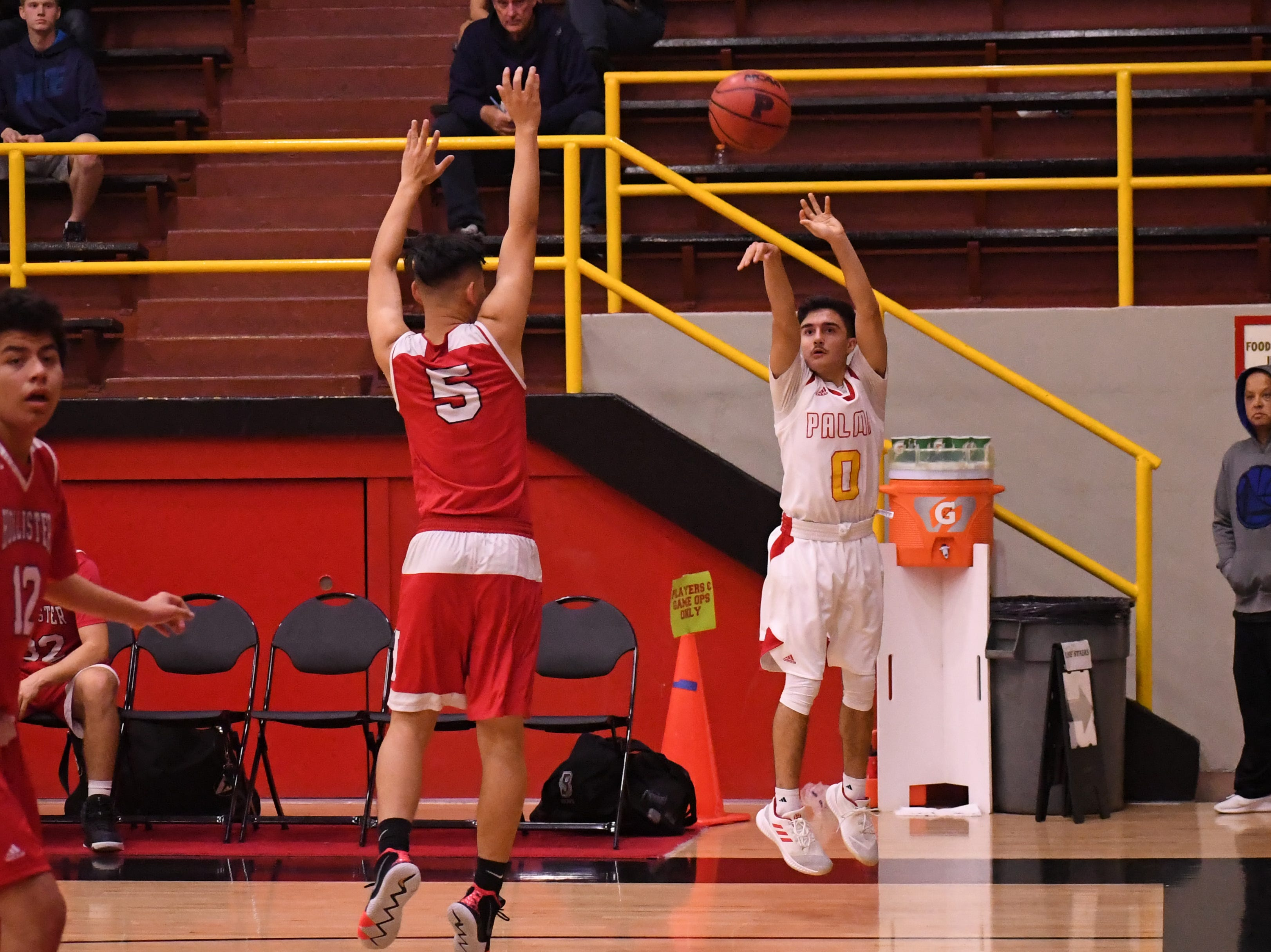 Palma guard AJ Suniga (0) makes one of his pair of 3-pointers in the game against San Benito.
