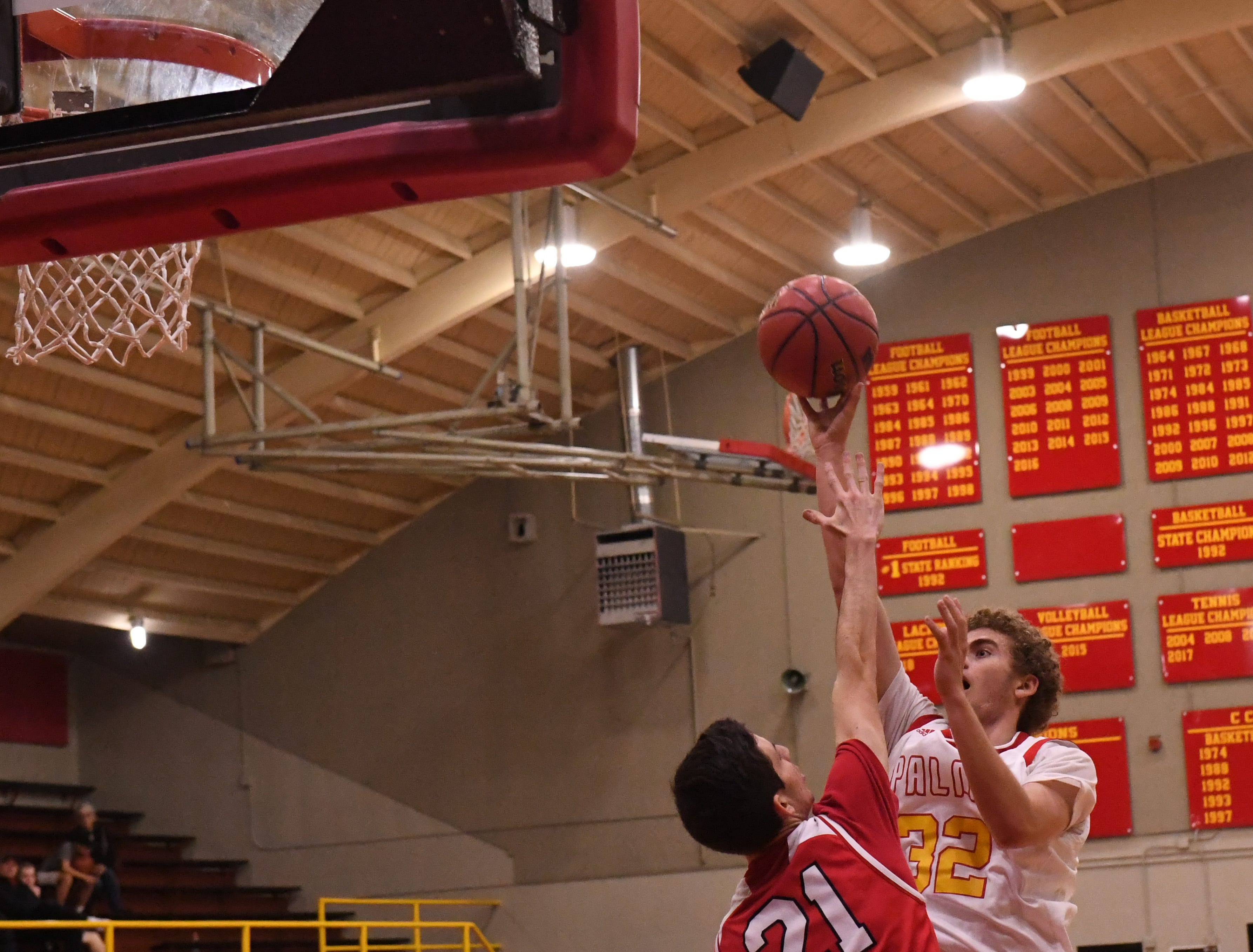 Palma forward Colin Neff (32) releases a shot in the lane over a defender.