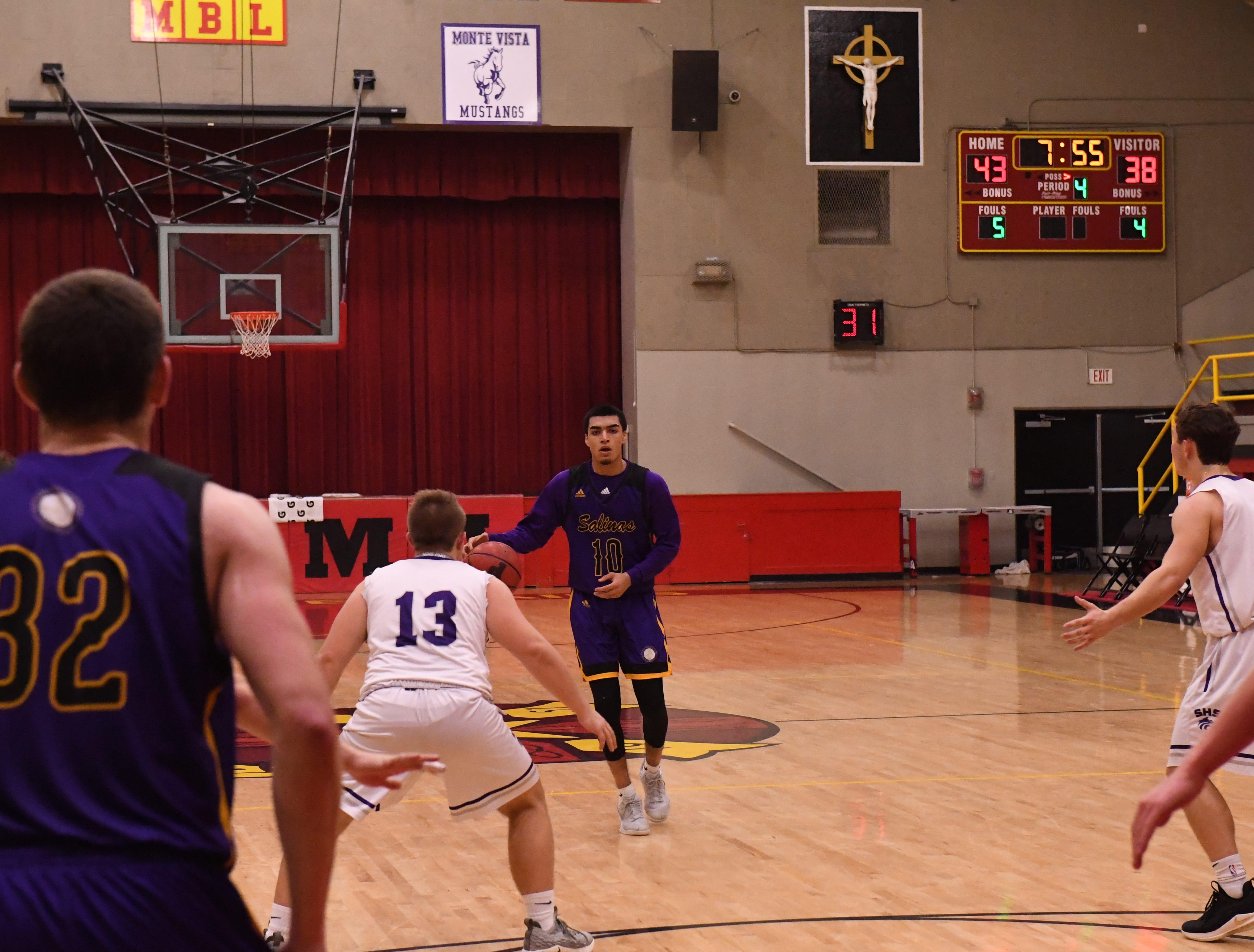 Salinas guard AJ Saldana (10) surveys the defense before calling a play.