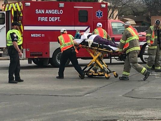 Woman carried to ambulance