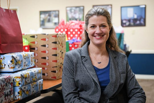 Pamela Gregory poses in front of a collection of charitable gifts in the United Way of the Lower Eastern Shore offices in Salisbury shortly after she was named the new President and Chief Executive Officer of the foundation on Monday, Dec 17, 2018.