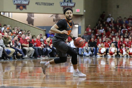 Oklahoma St guard Mike Cunningham looks to pass the ball during the OSU vs Nebraska game at the Sanford Pentagon in Sioux Falls, SD Sunday night.  Nebraska won 79-56.