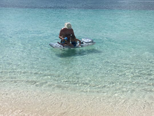 The water is so clear at Grace Bay, Turks and Caicos. My daughter was only 5, so we put floaties on her arms and gave her a mask and she swam right alongside us.