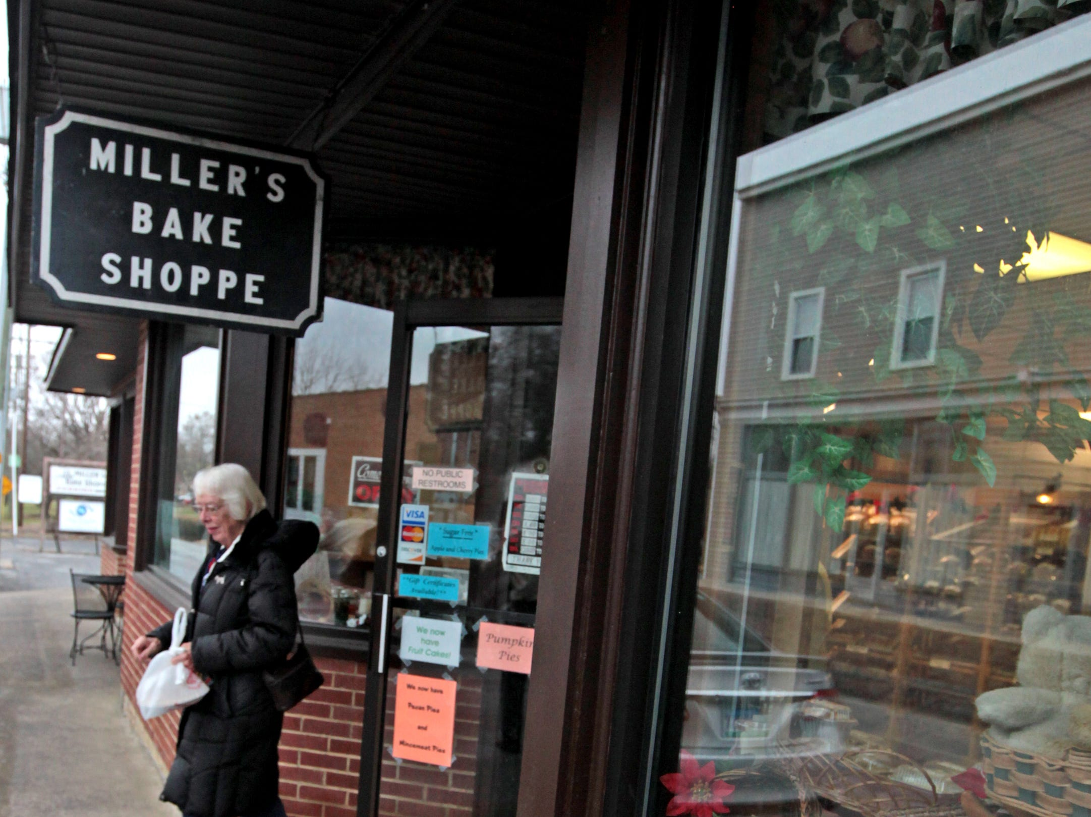 Customers come and go with baked goods at Miller's Bake Shoppe in Stuarts Draft on Dec. 1, 2018. The bakery sells dozens of traditional fruitcakes every holiday season.