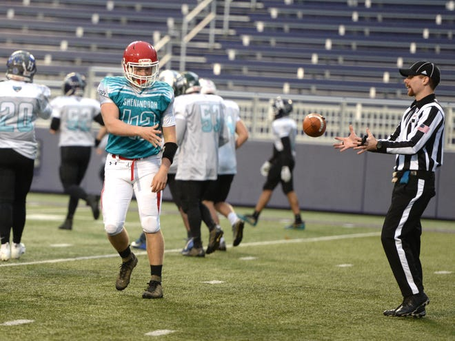 Riverheads' Moose Lee tosses the ball to the official after scoring on a two-point conversion during the Valley FCA all-star football game Sunday afternoon at JMU's Bridgeforth Stadium.