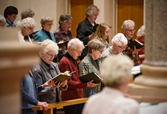 Sisters gather in song in Sacred Heart Chapel during mass Monday, Dec. 10, at St. Benedict's Monastery in St. Joseph.