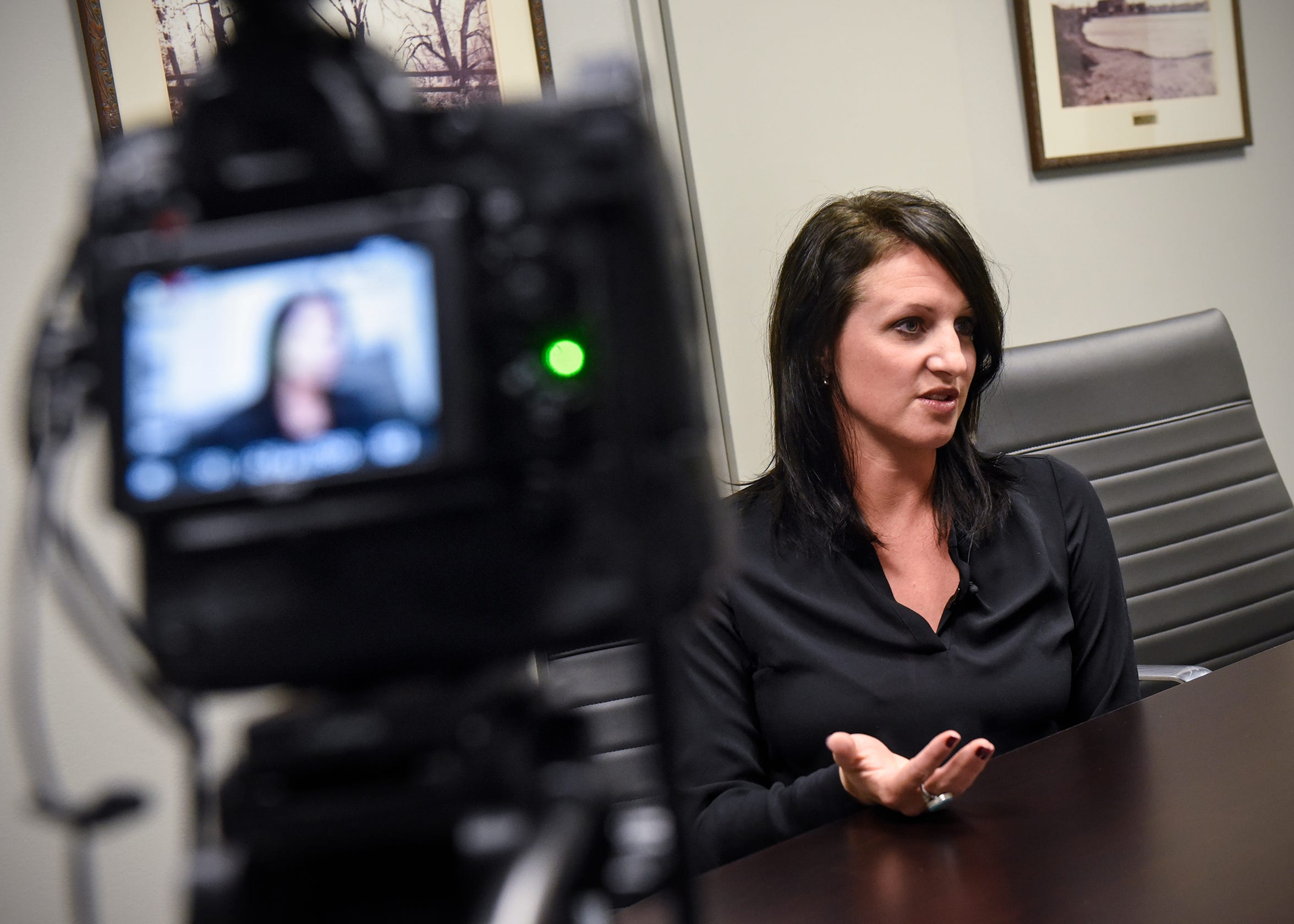 Moss & Barnett Business Development Director Shannon Wiger outlines her background during an interview Wednesday, Dec. 12, in St. Cloud.