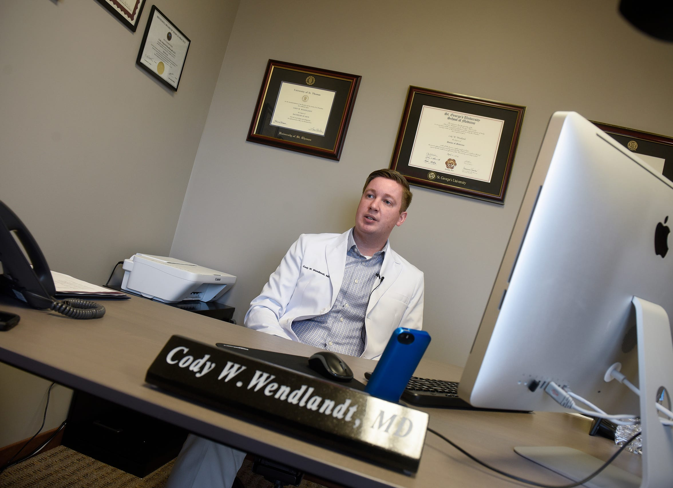 Dr. Cody Wendlandt talks about his practice Monday, Dec. 10, at Sartell Family Medicine in Sartell.