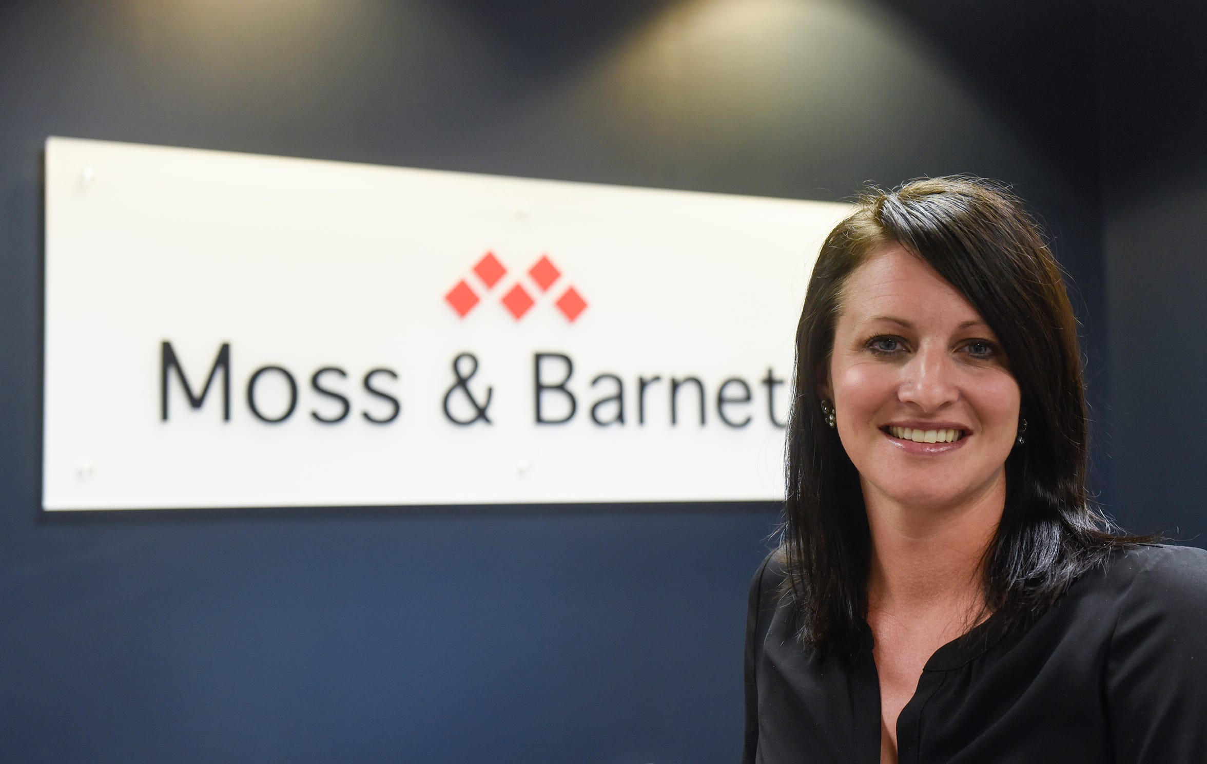Moss & Barnett Business Development Director Shannon Wiger poses for a photograph Wednesday, Dec. 12, in St. Cloud.
