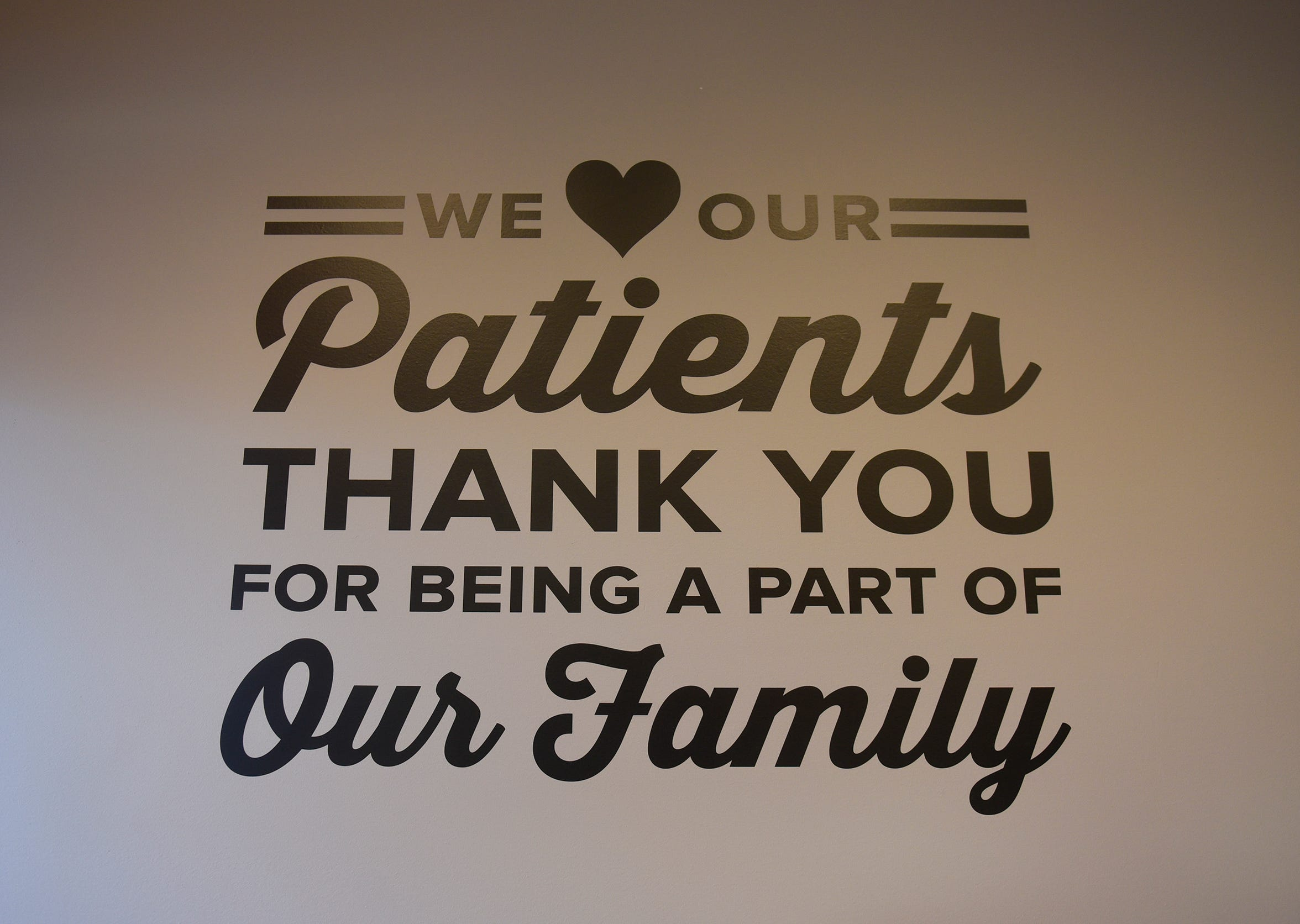 A saying is stenciled near the entrance to Sartell Family Medicine.