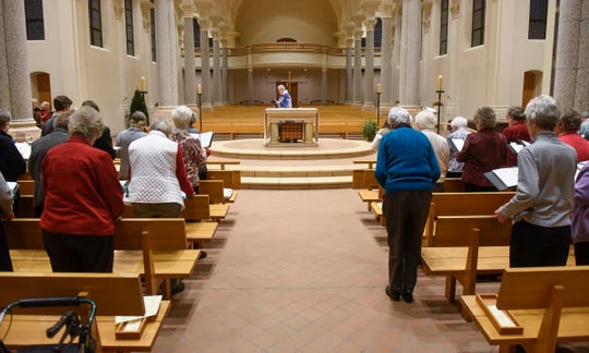 Sisters stand in Sacred Heart Chapel during mass Monday, Dec. 10, at St. Benedict's Monastery in St. Joseph.