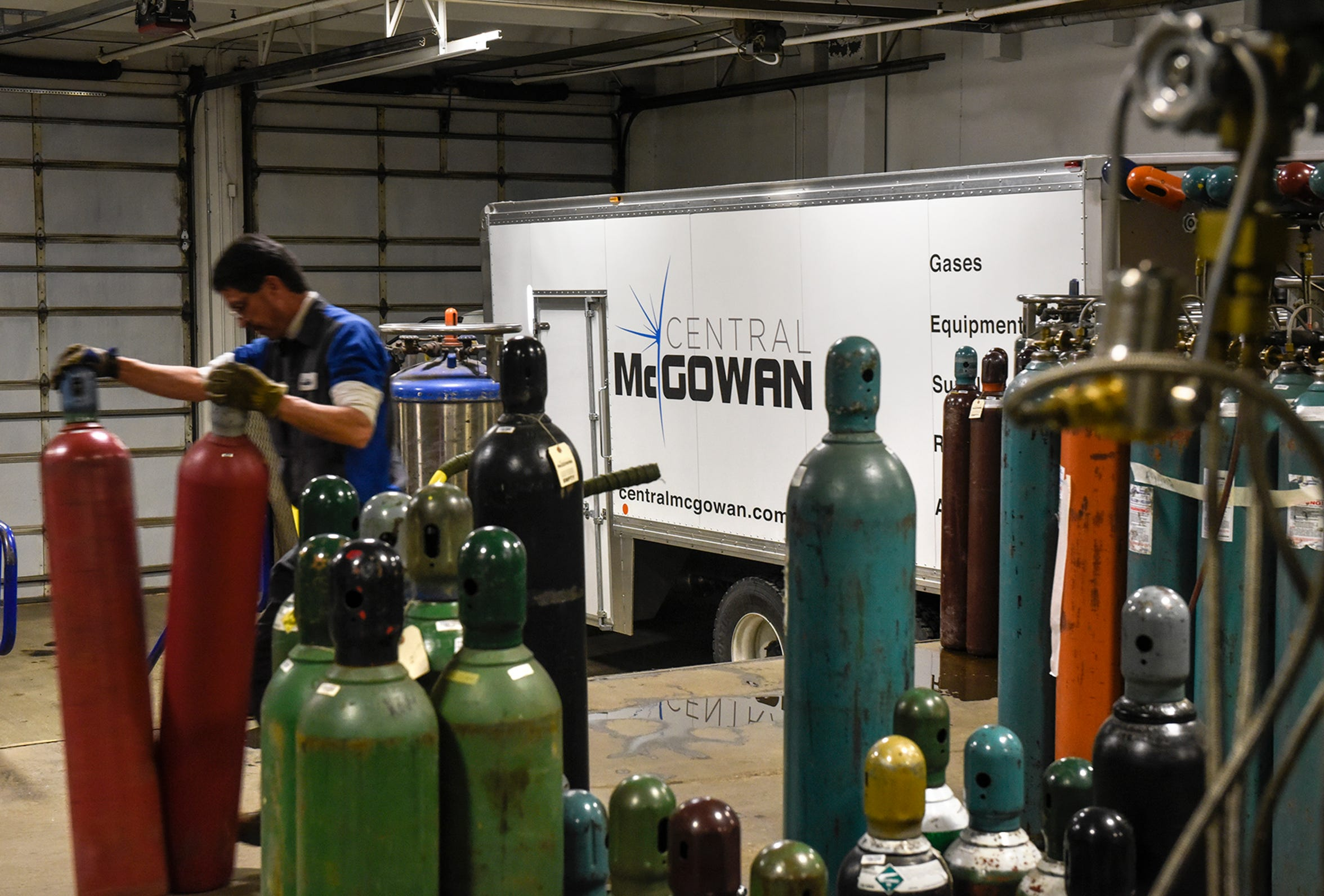 Cylinders are loaded for delivery at Central McGowan Thursday, Dec. 6, in St. Cloud.