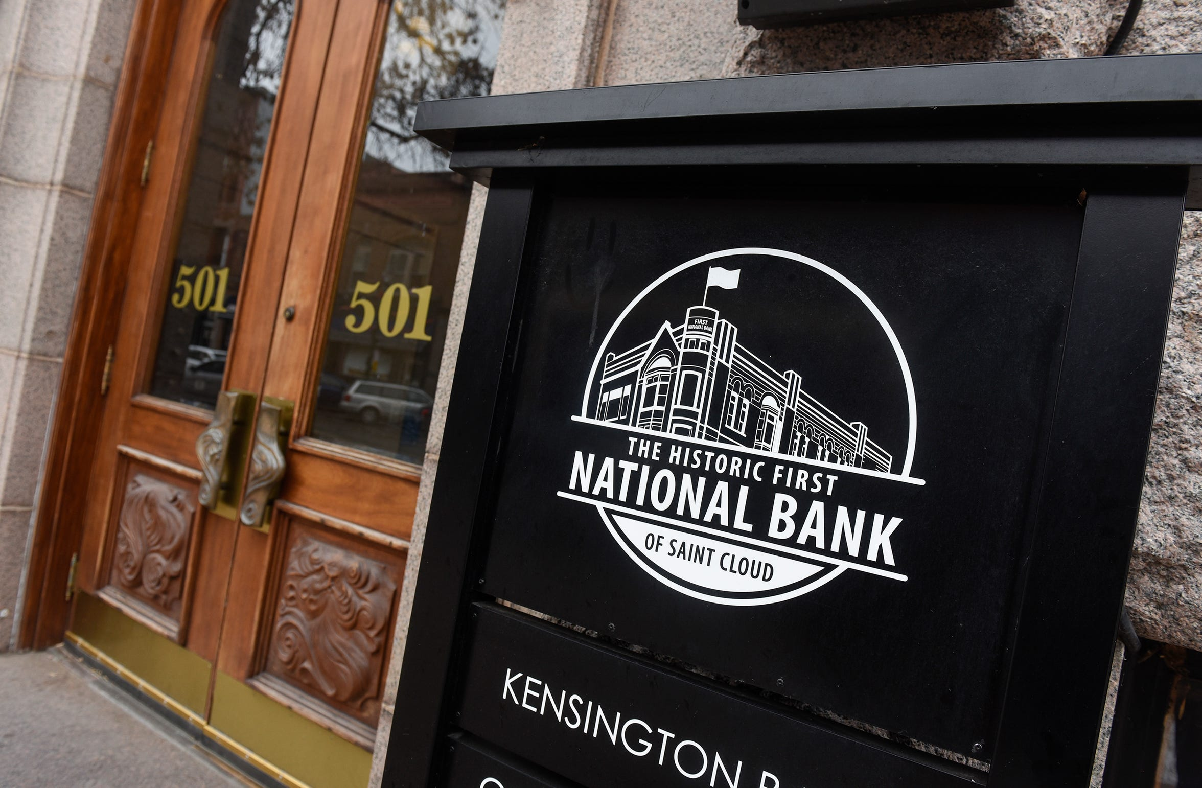 A sign stands near the entrance to the First National Bank building in downtown St. Cloud.