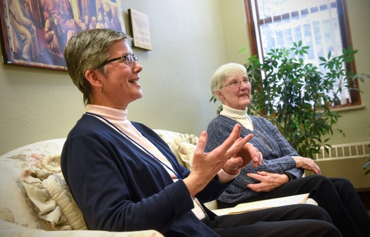 Franciscan Sisters Michelle L'Allier, left, and Elise Saggau talk about the history of their community during an interview Tuesday, Dec. 11, in Little Falls.