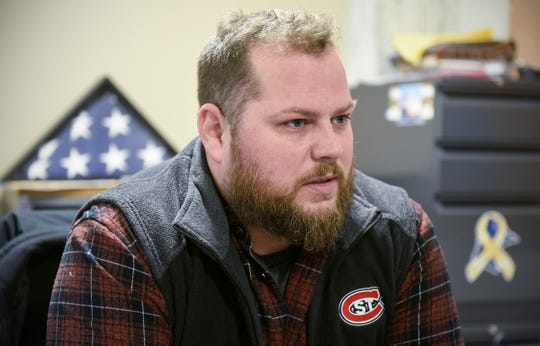 Director Zac Mangas talks about the work of the Veterans Resource Center Monday, Dec. 17, at St. Cloud State University.