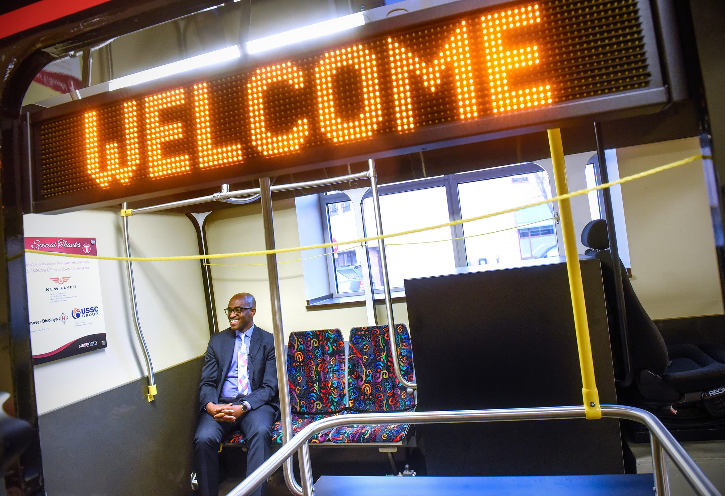 Metro Bus CEO Ryan Daniel smiles while talking about his work during an interview Friday, Dec. 7, at  the Metro Bus Mobility Training Center in St. Cloud.