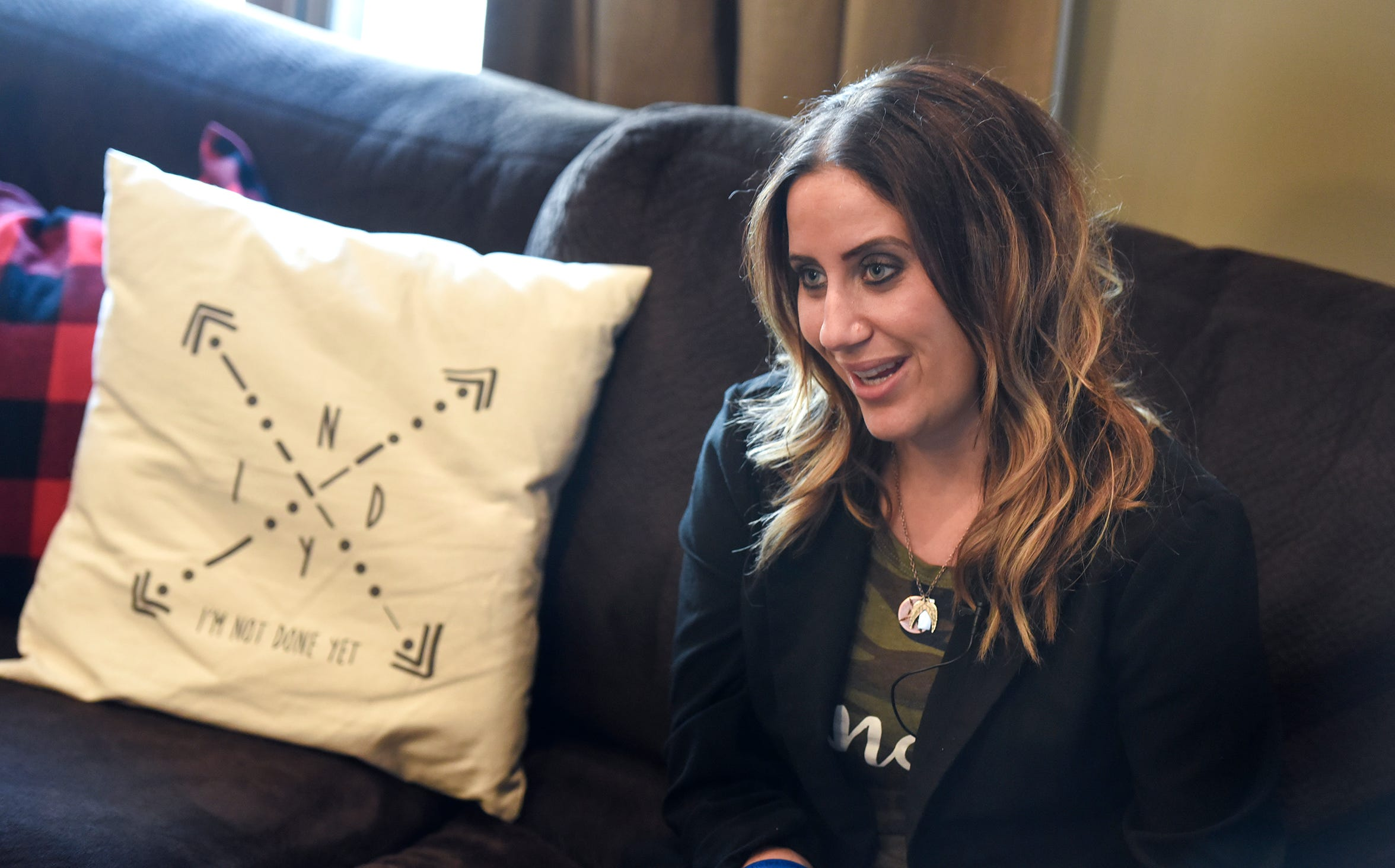 INDY Foundation founder Kayla Strand talks about her work during an interview Thursday, Dec. 13, at her home.