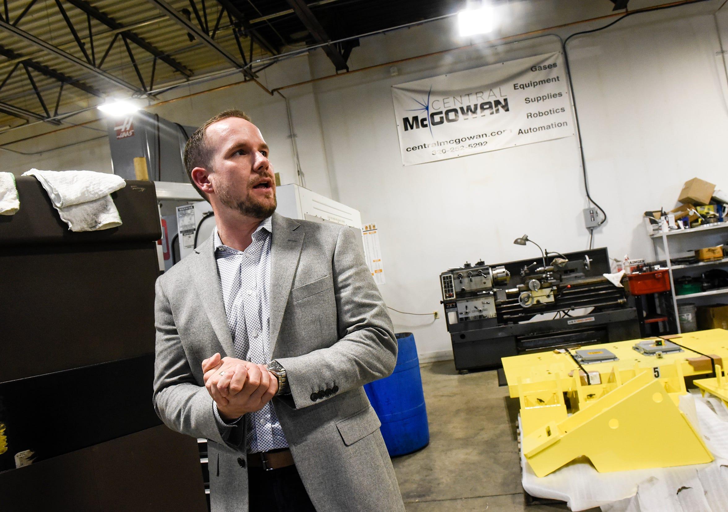 Central McGowan President and CEO Joe Francis talks about the company's robotics program Thursday, Dec. 6, in St. Cloud.