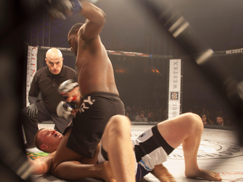 Cameron Cooper, in the blue corner, defeats Bailey Hogan during Mayhem in Mesquite at the Casablanca Saturday, Dec. 15, 2018.