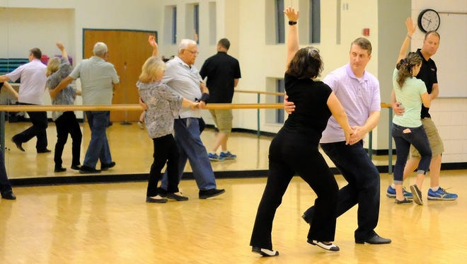 Community members participate in a dance class offered through a community education program at Southern Utah University. SUU instructors James and Toni Sage offer a class called social dance.