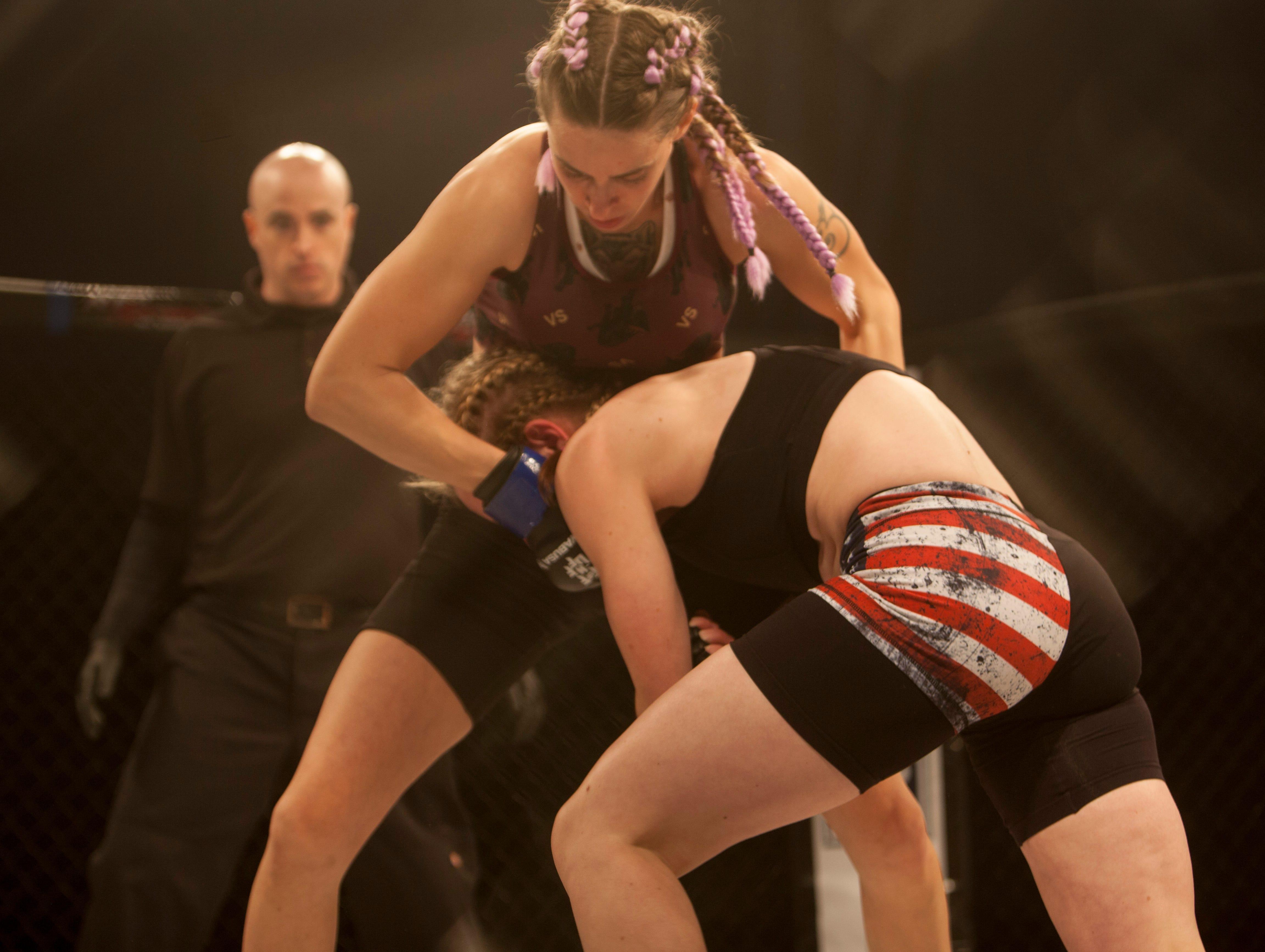 Kaycee Pearce, in the red corner, defeats Sadie Ault during Mayhem in Mesquite at the Casablanca Saturday, Dec. 15, 2018.