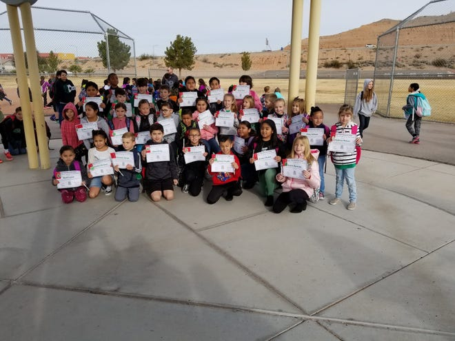 Students at Virgin Valley Elementary celebrate receiving their Buddy Bench on Dec. 14, 2018