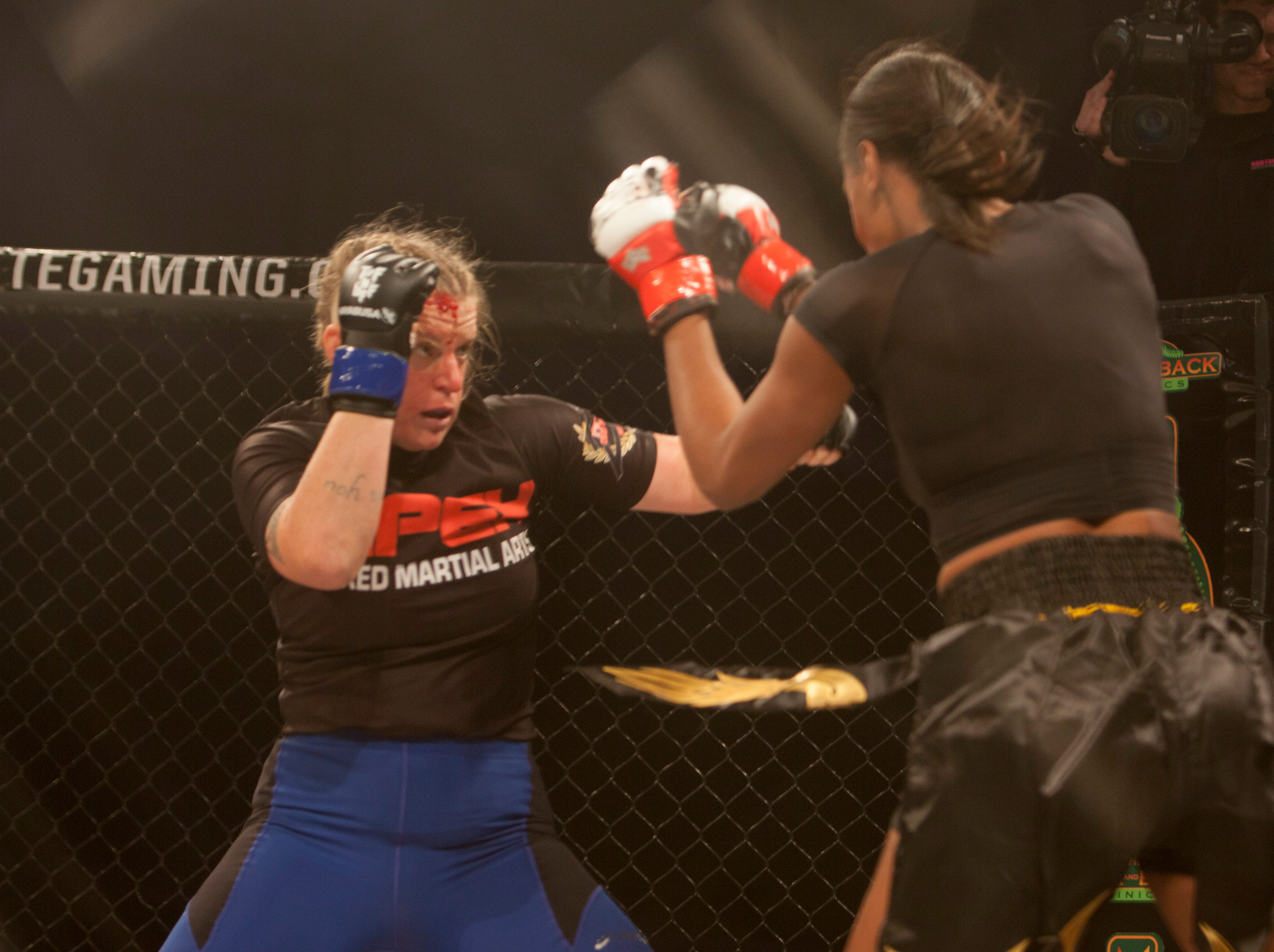Elizabeth McMullin, in the blue corner, defeats Brandi Buckley during Mayhem in Mesquite at the Casablanca Saturday, Dec. 15, 2018.
