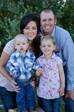 Amanda and TJ Atkin and their two children own and operate the Top Hat Ranch, keeping up a family tradition of agriculture that goes back six generations in southern Utah.