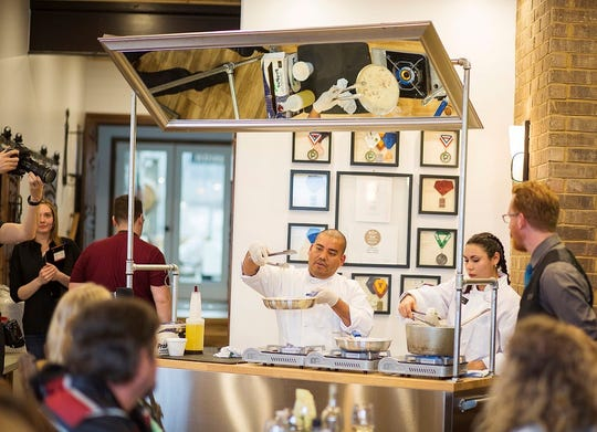 Chef Gerardo Reyes from Chef Alfredo's Ristorante Italiano teaches participants of Southern Utah Chef how to prepare a stuffed chicken breast
