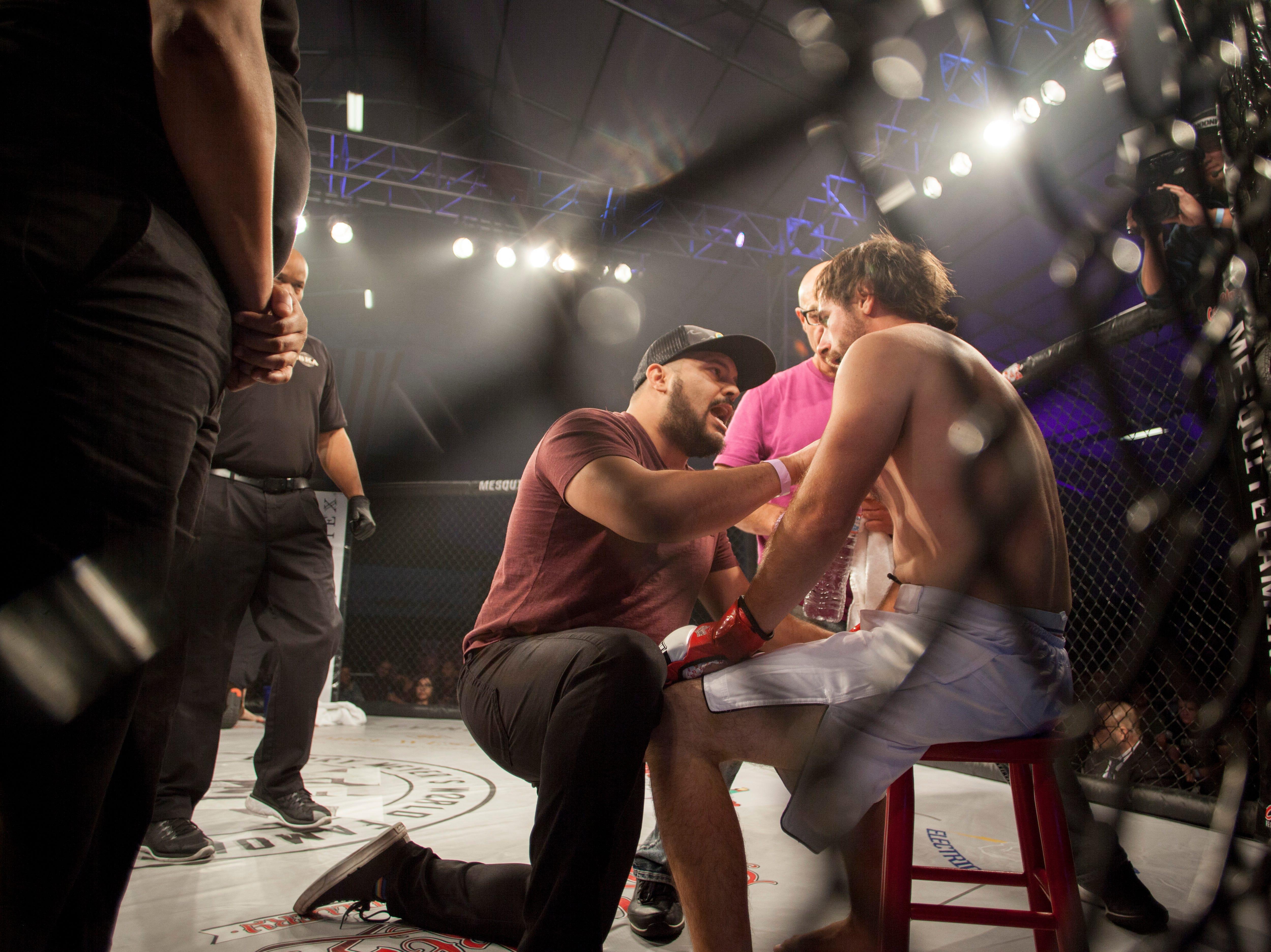 Brandon Honsvick, in the blue corner, defeats Tylor Kates during Mayhem in Mesquite at the Casablanca Saturday, Dec. 15, 2018.