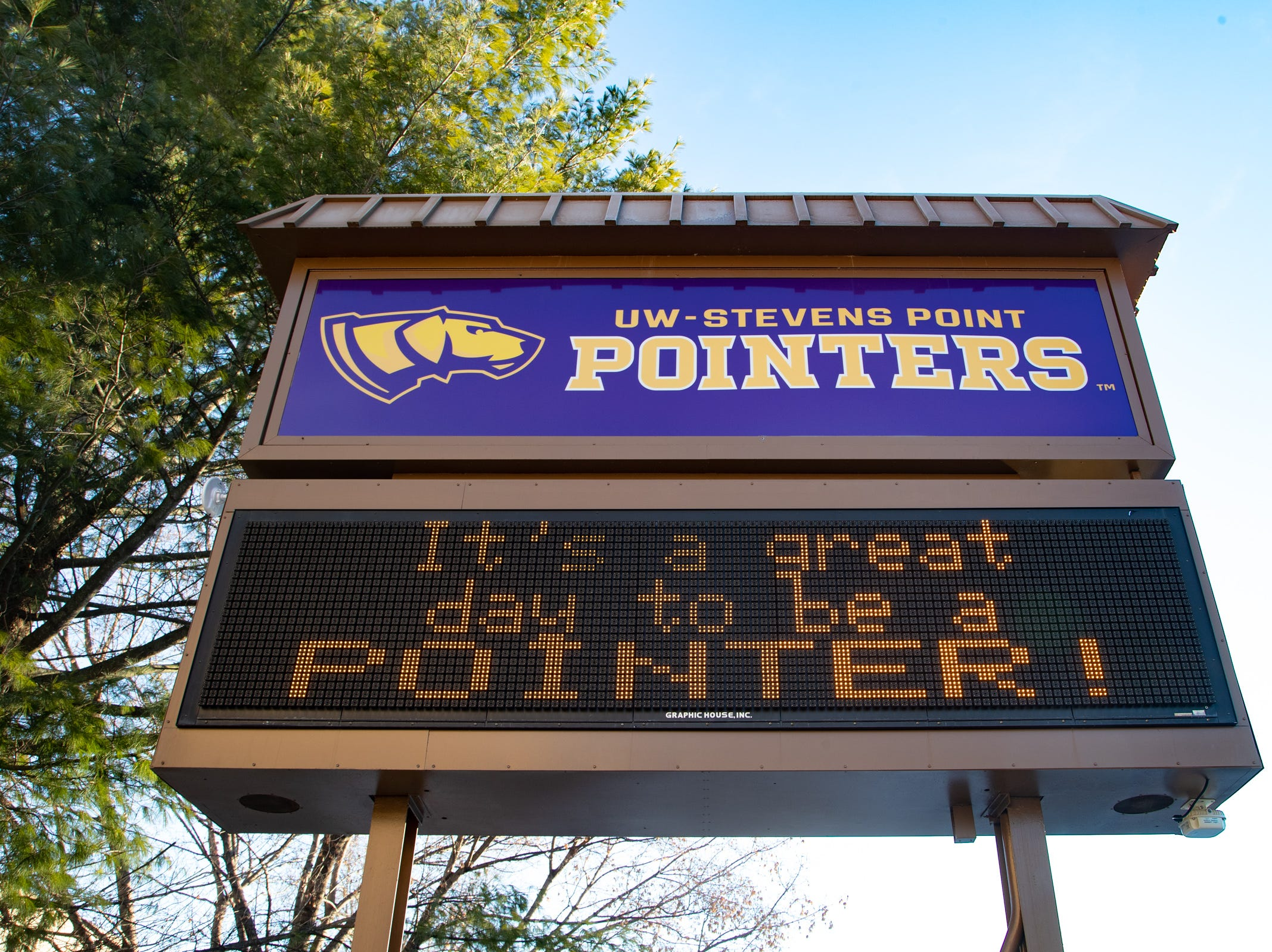 A sign welcomes  graduates and their families to the 2018 winter commencement ceremony at the University of Wisconsin-Stevens Point on Dec. 15, 2018, in Stevens Point, Wisconsin.