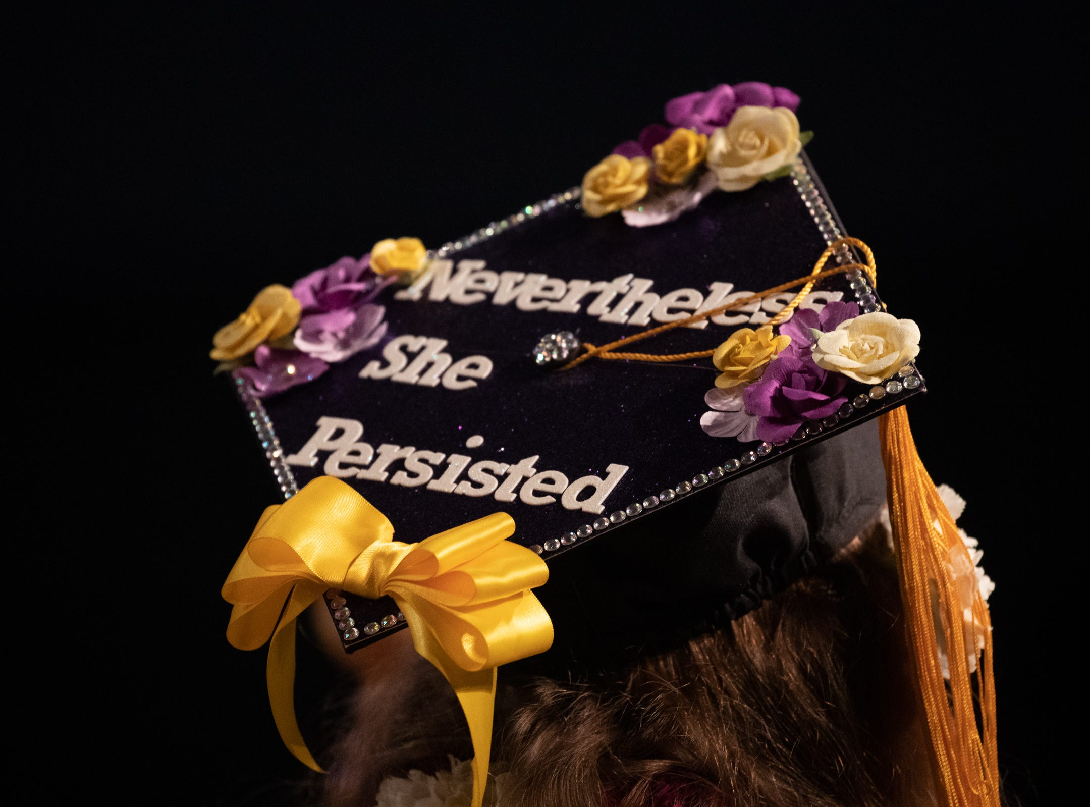 A graduate listens to speakers during the 2018 winter commencement ceremony at the University of Wisconsin-Stevens Point on Saturday, Dec. 15, 2018, in Stevens Point.