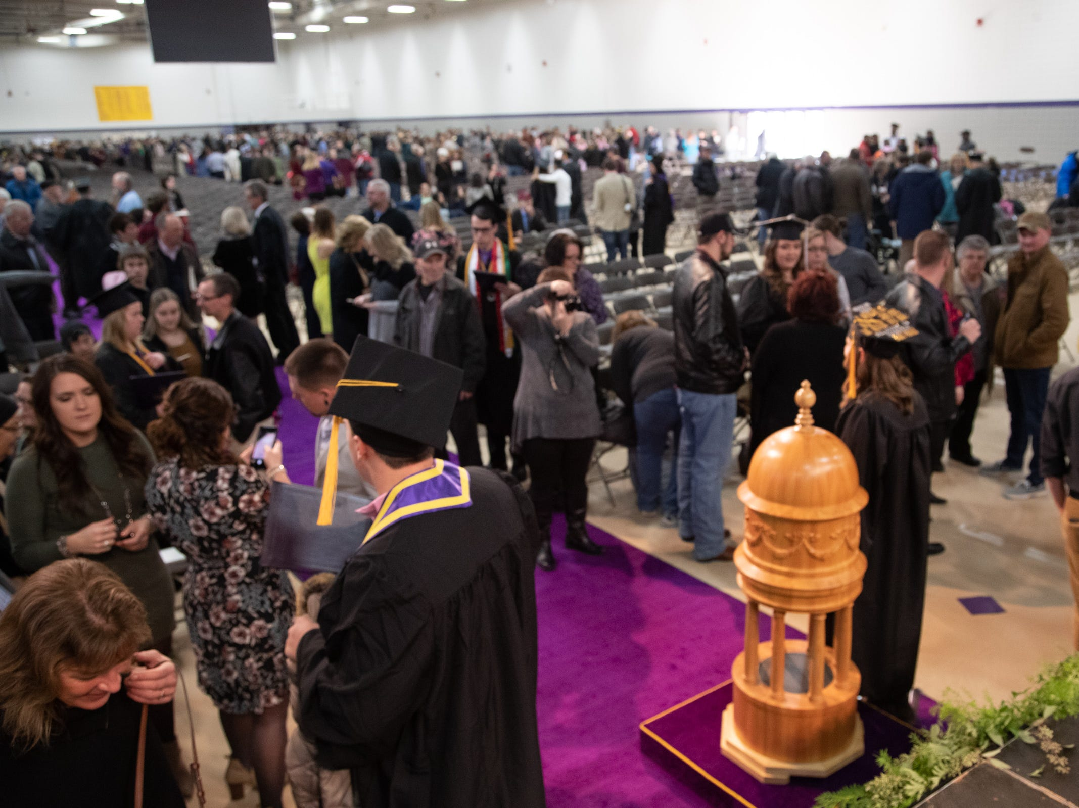 Faculty, graduates and their families mingle after the 2018 winter commencement ceremony at the University of Wisconsin-Stevens Point on Saturday, Dec. 15, 2018, in Stevens Point.
