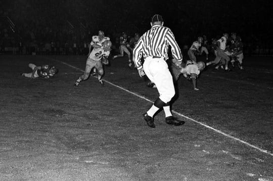 FSU #28 T K Wetherell running with the football during a game in Tallahassee against the University of Houston