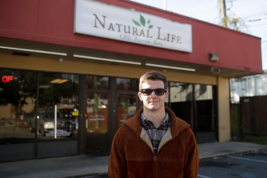 Manager Alex Petrick stands in front of Natural Life CBD store on Pensacola Street in Tallahassee Monday, Dec. 17, 2018. Three shipments have been seized by authorities.