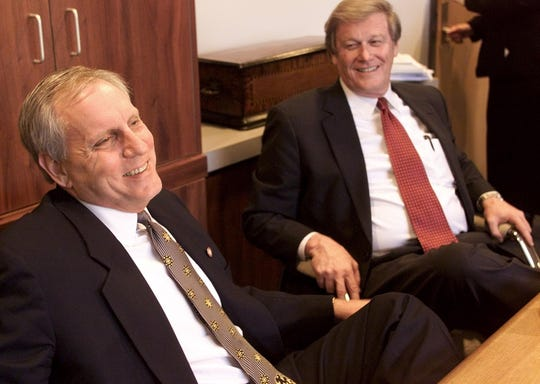 Florida State University President T.K. Wetherell, left, sits next to Florida State University Board of Trustees chairman John Thrasher while answering questions from the media during a press conference on Tuesday, December 18, 2002 at the FSU Broadcast Center in Tallahassee, Fla.