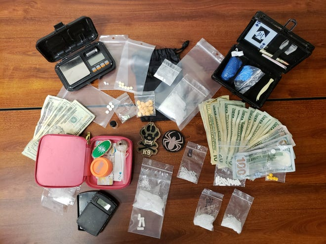 LCSO found 56 grams of methamphetamine, digital scales, plastic baggies, Xanax and Oxycodone pills, drug paraphernalia and a stolen laptop.