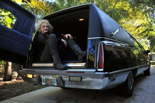 Camille Sands, 68, a retired burlesque dancer, is seen with her method of transportation, a Cadillac & Buick hearse parked at her home on Jan. 27th, 2015 in Fort Pierce. Sands' 20-year career as a burlesque dancer spanned the 60's to the 80's.