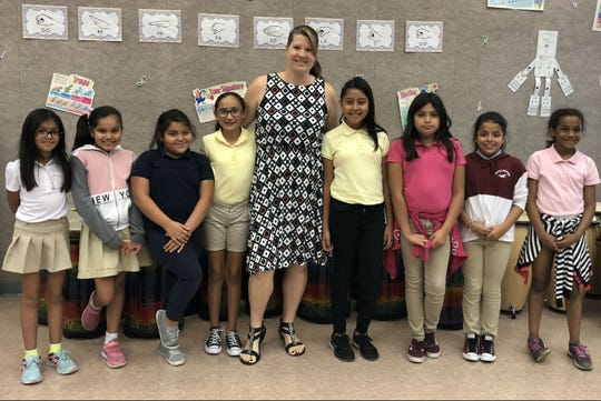 "Fellsmere Elementary students appearing in ""The Nutcracker on the Indian River"" from left: Zulimar Andrade, Jimena Escobar, Admily Brinas, Yareli Gamez, music teacher Sara DiPardo, Estefania Martinez, Giselle Guerra, Tanya Chavez and Naima Williams. Not pictured: Leslie Zamarripa."