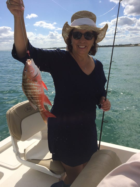 Lillian with a mutton snapper and enjoying Florida weather while visiting from NY.