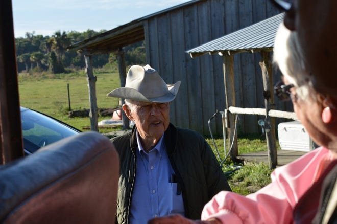 The late Bud Adams welcoming visitors to his ranch.