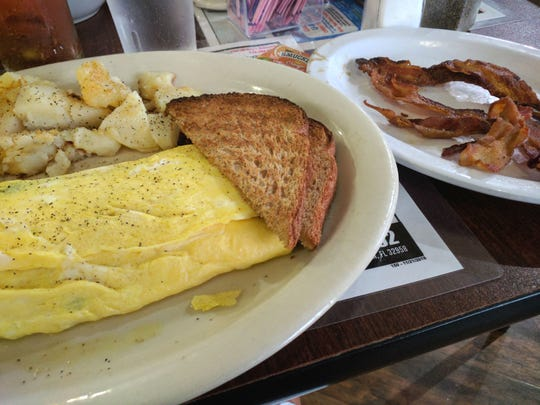 Pelican Diner's spinach and feta omelet  served with home fries and toast. The side of bacon was extra.