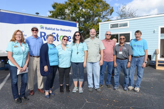 Melissa Winstead, left, Bob Calhoun, Tonya Mills, Sarah Tucci, DonnaLea Askman, Will McLaughlin, Dave Carling, Jim Braxton and Jody Grizz on Dec. 7 at the St. Lucie Habitat for Humanity ReStore in Port St. Lucie on U.S. 1.